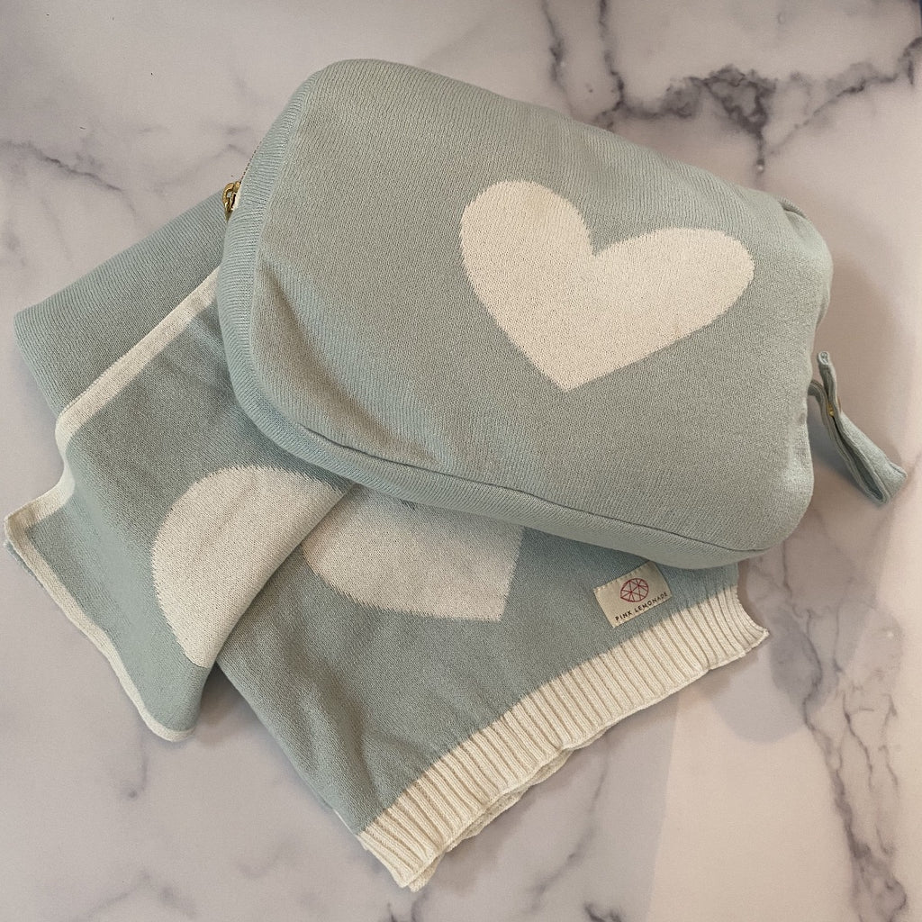 A 100% cotton blanket and burp cloth that comes in a zippered carrying pouch.  This is the perfect baby gift, made in India by Pink Lemonade.  Light blue and white with a heart motif on all three pieces.  Machine washable, soft, and beautifully made.