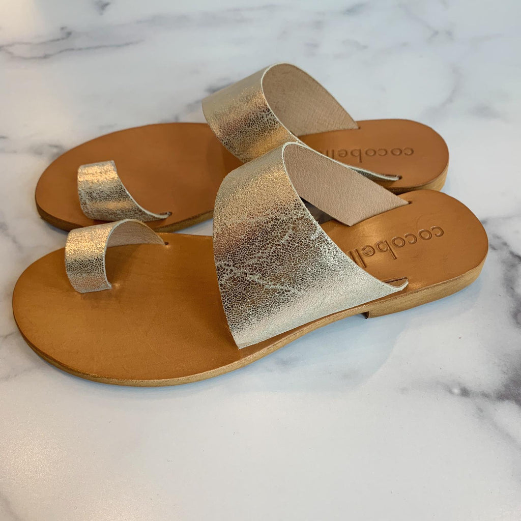Flat leather sandals handmade in Italy by Cocobelle.  The Aria sandal is made from butter soft leather in a pale gold color.  Meant to get more comfortable with wear, they look great with any summer dress, shorts, or even jeans.