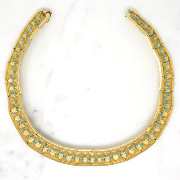 Egyptian Revival Choker, Boucher  Designer: Boucher  Material: gold plated metal, glass  Period: 1950s. Available at Fonfrege.com