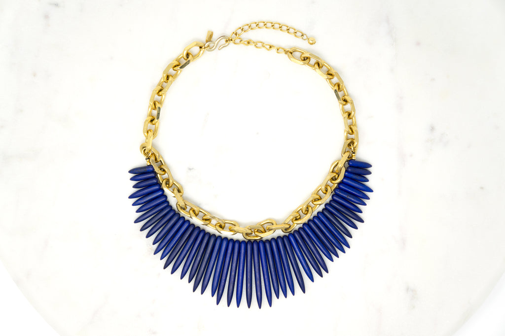 Gold and Lapis Necklace Designer: Kenneth Jay Lane (KJL) Material: gold plated metal, bakelite, faux lapis lazuli. Available at Fonfrege.com