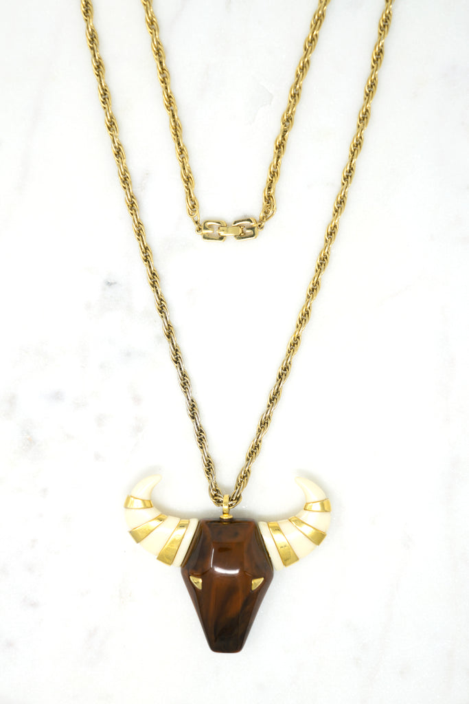 """Taurus"" Bull Pendant Designer: Givenchy Material: gold plated metal, resin Period: 1960s Available at Fonfrege.com"