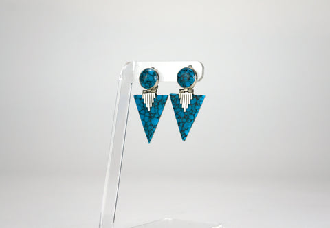 A beautifully geometric pair of art-deco earrings, made from composite turquoise and sterling silver (925). Marked Mexico, they are most likely from Taxco.