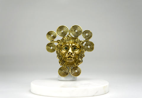 "A large and bold dimensional lion head brooch surrounded by an artfully coiled ""mane."" He has glittering green gem eyes. The brooch also features a hook which enables it to be worn as a pendant.  Period: 1960's Designer: Goldette. Available at fonfrege.com"
