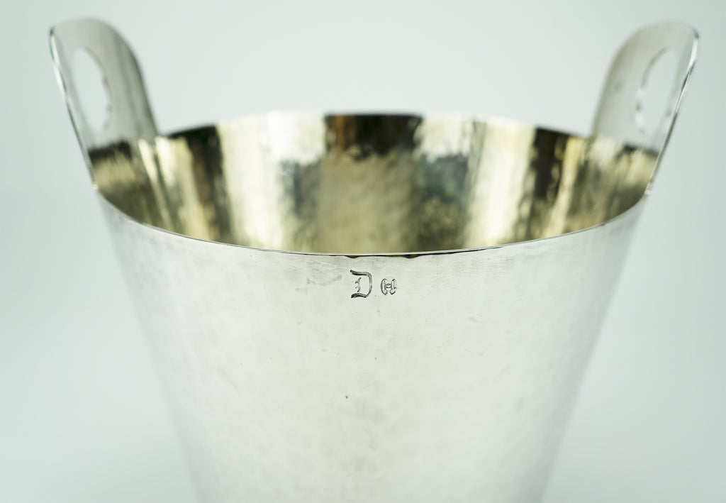 "Calegaro was founded in 1921 and is one of Italy's most famous silversmiths. This midcentury champagne bucket is hand-finished with hammered silverplate. Hallmarked at the rim. Very good condition with very minor wear.  Designer: Calegaro Period: Early 1960s Material: Silverplate Dimensions: 7""x 8"" Condition: Very good. Available at fonfrege.com"