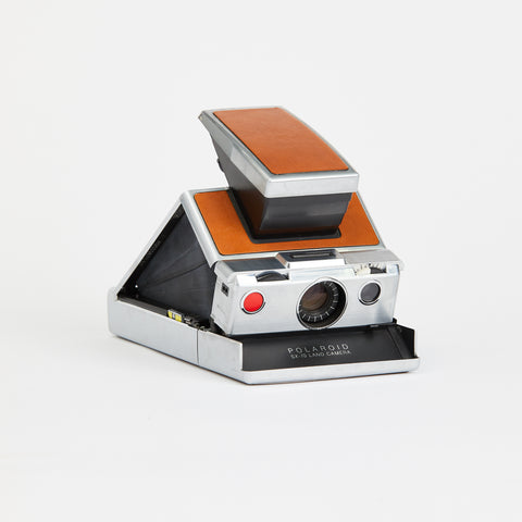 "The icon. The legend. We are thrilled to offer an original, NIB new-in-box Polaroid SX-70. When it was launched in 1972, it instantly became a favourite for such artists such as Andy Warhol, Richard Avedon, and David Hockney. Known as the ""magic camera,"" it can be found in major museum collections around the world. Film can be purchased through The Impossible Project. This camera has passed basic functionality and performance standards. Available at fonfrege.com"