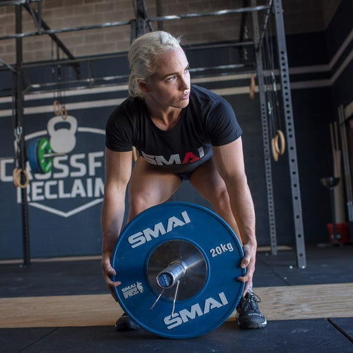 Crossfit Games athlete lifting SMAI Competition Bumper Plate.