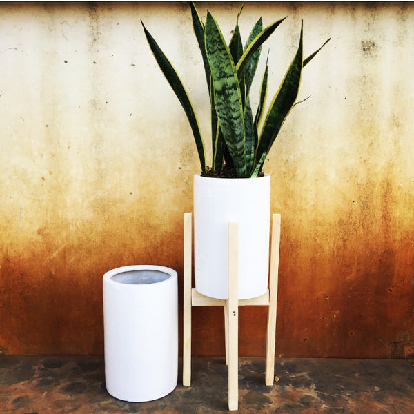 Cylindrical planter with wooden stand