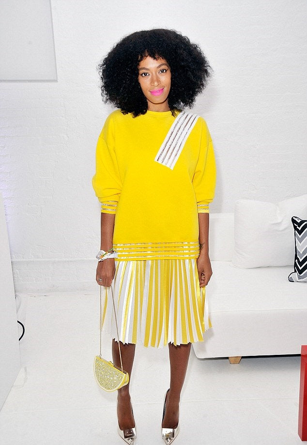 Solange-In-Christopher-Kane-Resort-2014-Yellow-Sweatshirt-And-Pleated-Skirt-At-The-QQ-Launch-Event-11