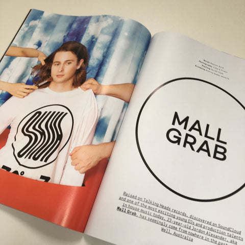 Mall Grab wears white long sleeve ghost T-shirt by Okuh Studios mens streetwear fashion brand in Mixmag