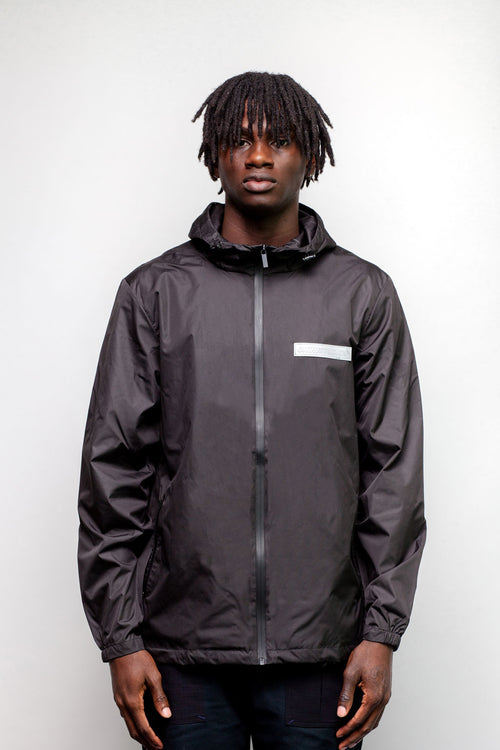 Black Reflective Tech Jacket by Okuh Studios, mens streetwear fashion brand, Front Worn