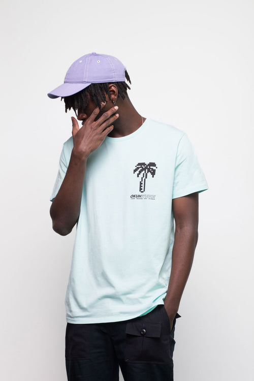 Blue Pixel Palm Chest T-shirt by Okuh Studios, mens streetwear fashion brand, Front Side Worn