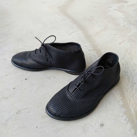 Black perforated oxford shoes. 1021p