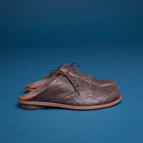 Brown oxford mules. 1023