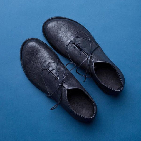 Black oxford shoes. 1021