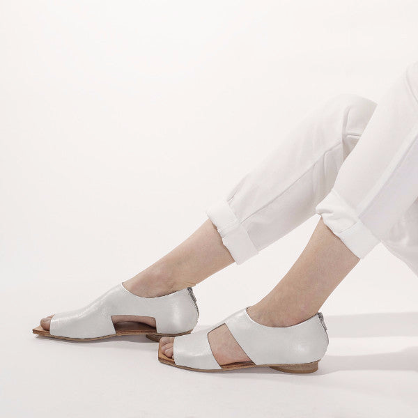 White cut out sandals. 48
