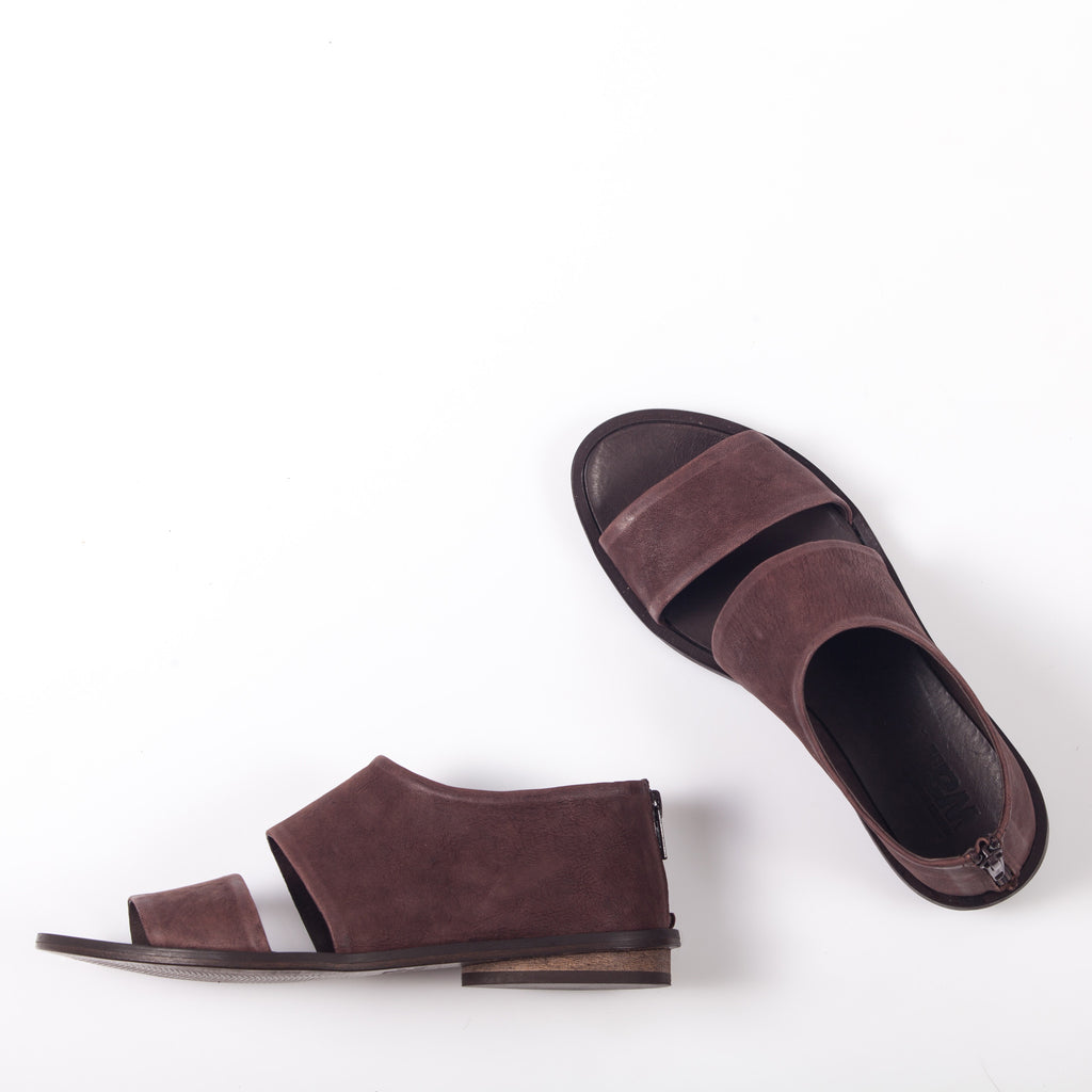 Flat sandals in Brown. 93