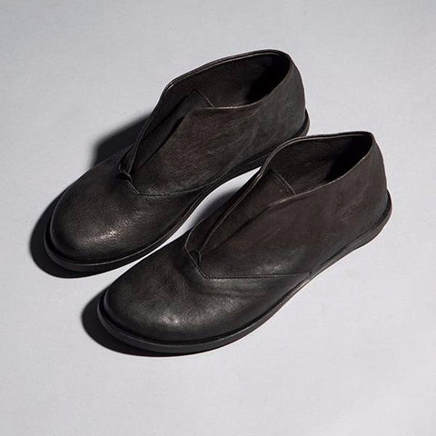 Black unlaced oxford shoes