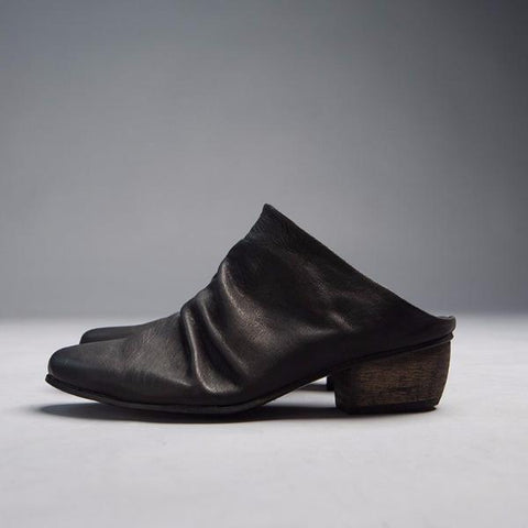 Black slouch pointy toe Pleated mules. 4747