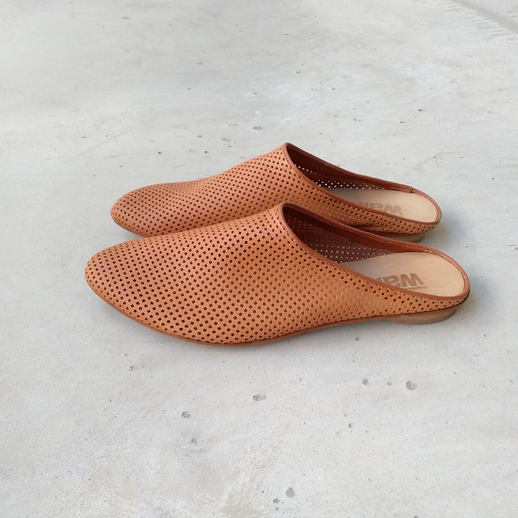 Camel perforated Slip on mules. 453