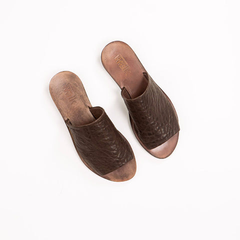 Brown leather slides. 46