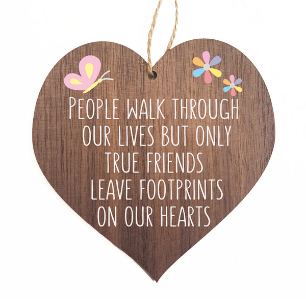 People walk through our lives but only true friends leave footprints on our hearts