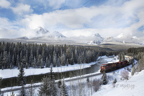 Winter wonderland image of a Canadian Pacific train roaring through rugged Canadian Rockies. Banff National Park. Alberta photography. Home decor by J2 Studios.