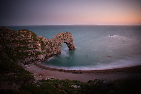 Image of the natural limestone sea arch on the Jurassic coast of Dorset, England. Landscape photography.