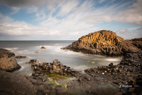 Dramatic Image of waves lapping on the Giant Causeway in Northern Ireland. Landscape Photography.