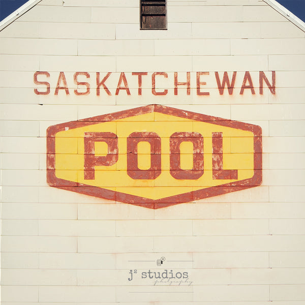 Fine art photography print of the iconic Saskatchewan Wheat Pool logo on a weathered grain elevator. Prairie photography.