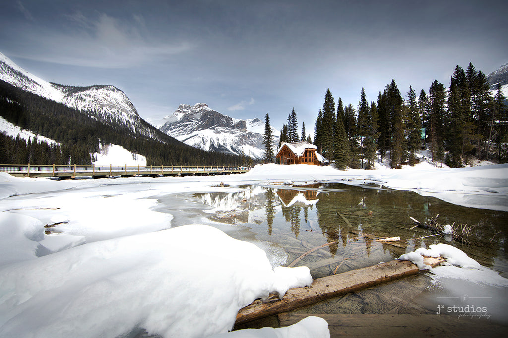 Image of Emerald Lake Lodge reflecting off the frozen romantic waters of Emerald Lake.  British Columbia Rockies photography.