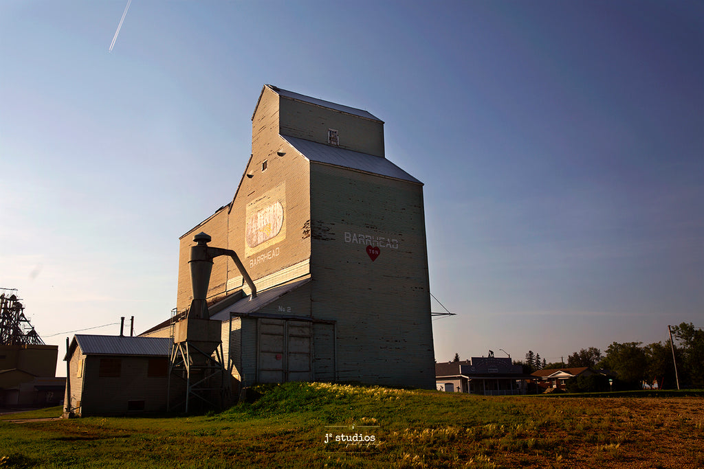Picture of the sun setting on the Grain Elevator in Barrhead.  Prairie Sentinel Photography by Larry Jang of J² Studios.