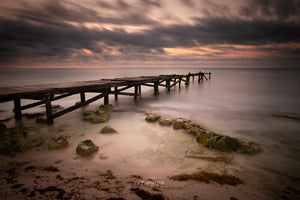 Positive image of a weathered pier bridging the Caribbean Sea at Sunrise. Mexico Photography. IMages of Paya del Carmen.