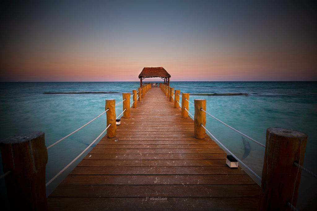 Photograph of a pier leading to a gazebo on the Caribbean Sea at Sunset. Peaceful Fine Art Photography.