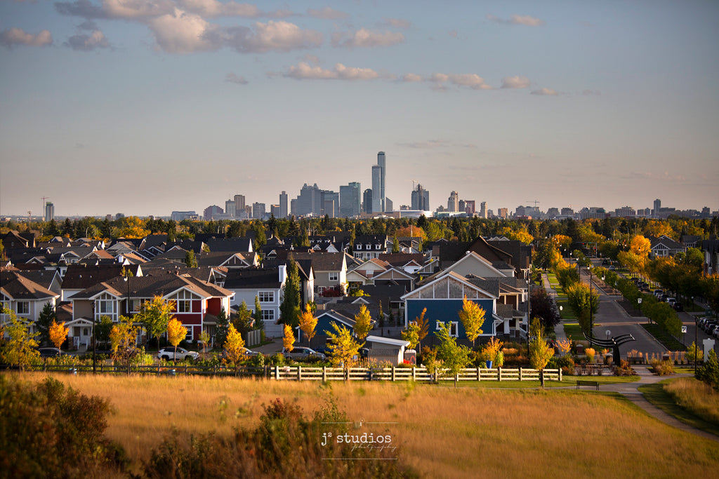 View of Edmonton Skyline from Griesbach Hill in Autumn. San Francisco vibe featuring colorful houses against metropolitan skyline.  Postcard image of YEG.