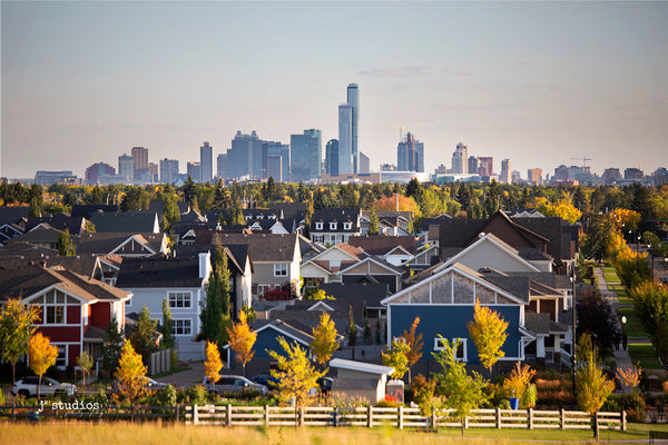 Edmonton Skyline looming over colorful houses of Griesbach neighbourhood. Fall postcard photography.