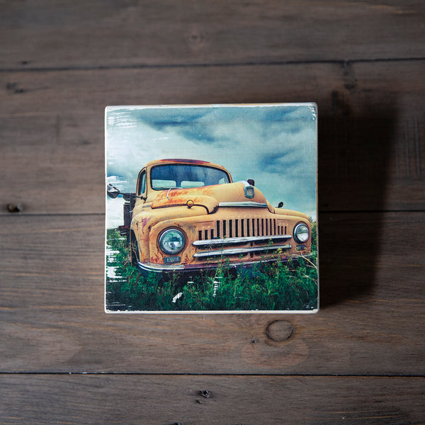 Photo Block featuring rusty 1950s International Truck sitting on a field in the Canadian Prairies. Handmade in Edmonton, Alberta, Canada by Larry & Christina Jang of J² Studios Photography & Craft. Masculine decor ideas for dad or grandpa, man cave or home or office.