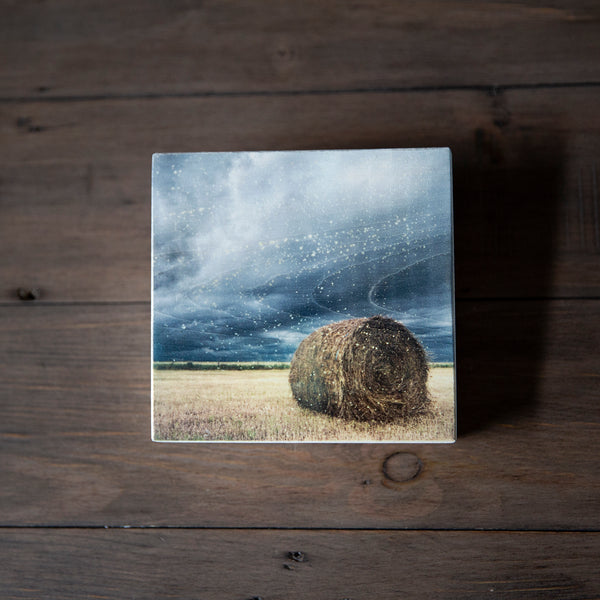 Photo Block featuring Hay Bale sitting under incoming storm clouds. Handmade in Edmonton, Alberta, Canada by Larry & Christina Jang of J² Studios Photography & Craft. Unique decor ideas for rustic modern homes or farmhouse.