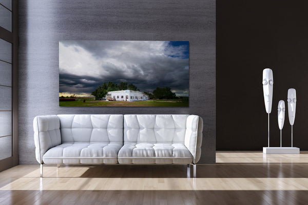 Wall decor ideas. Big canvas print depicting stormy weather on display in modern living room.