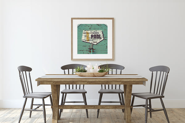 Framed Alberta Wheat Pool print on display in rustic dining room.