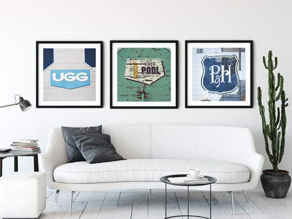 Collection of framed prints in modern living room of iconic Canadian wheat pool operators.