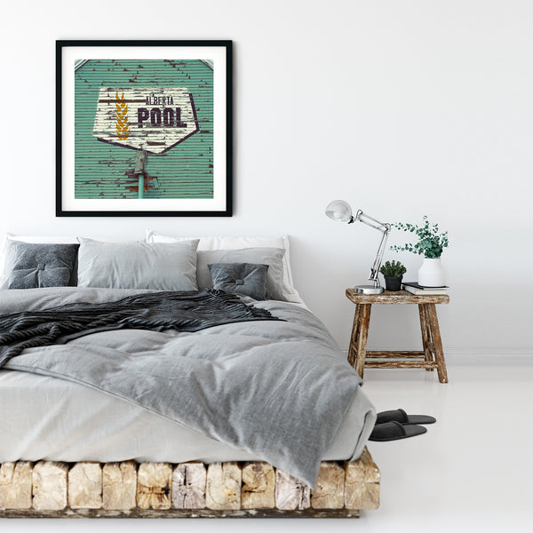 Framed print of chic and iconic Alberta Wheat Pool logo in rustic modern bedroom.