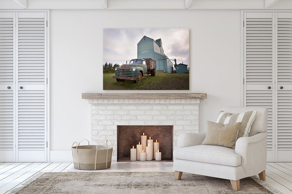Canvas of a Ford Jalopy Truck in front of Andrew, Alberta grain elevator. Canadian Prairies decor for living room with a fireplace.