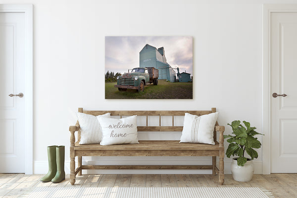 Canvas print of a rusty truck in front of grain elevator. Modern Farmhouse decor.