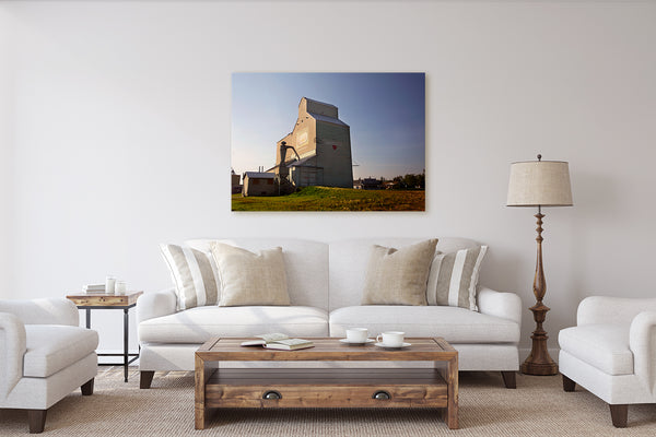 Canvas print of sunset in Barrhead on display in a rustic modern living room. Wall decor  by Larry Jang of J² Studios.