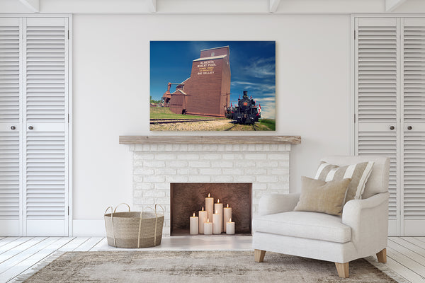 Canvas of a Steam Engine hanging above a fireplace mantle in a modern living room by Larry Jang.