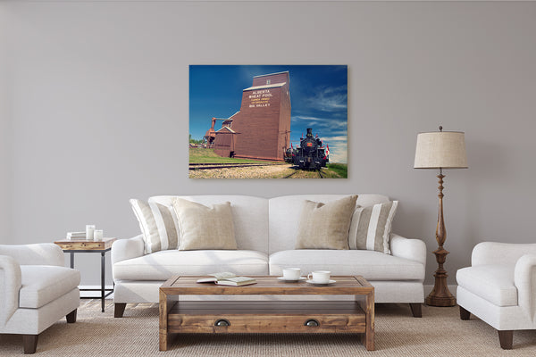 Canvas of a Train outside the Big Valley Grain Elevator hanging on a rustic modern living room. Wall decor ideas by Larry Jang
