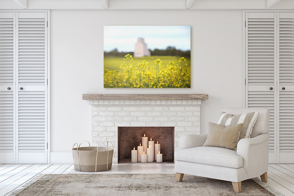 Living room decor with a fireplace ideas big canvas of canola flowers.