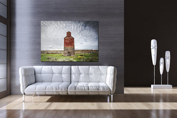 Big canvas print of Alberta Badlands hanging wall of a modern living room.