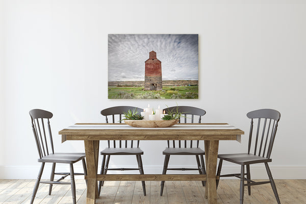 Big print of Grain Elevator in Badlands hanging in rustic modern dining room. Farmhouse decor.