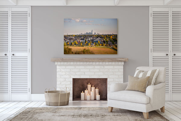 Canvas print of Edmonton & Griesbach on display in a living room with a fireplace.